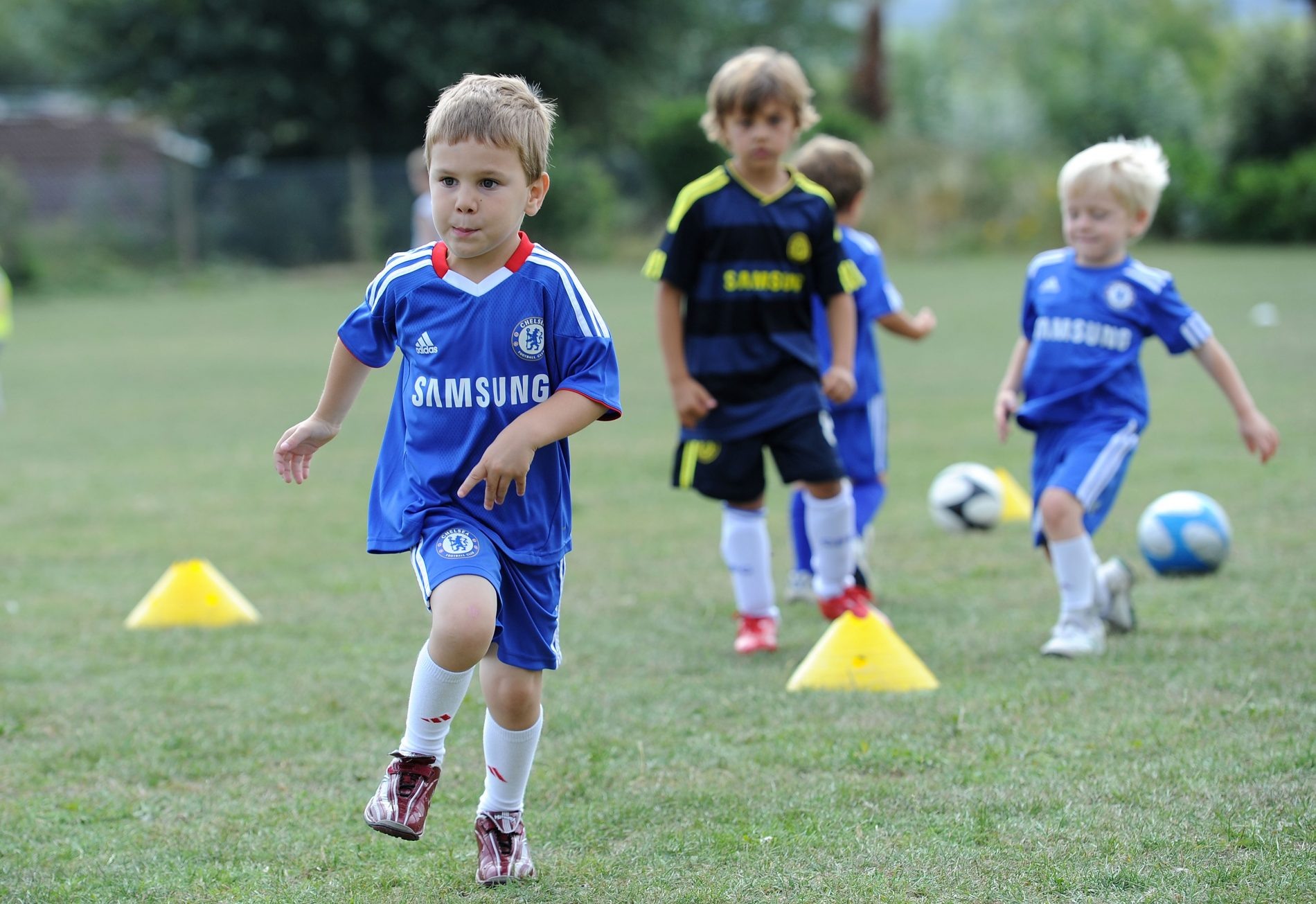 Get kids active at football schools this summer