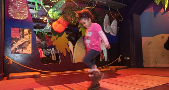 Girl jumping over bridge – Discover Story Centre