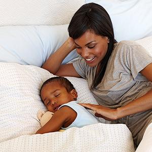 mum with sleeping toddler