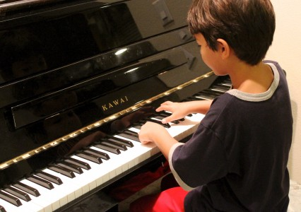 Piano Boy Playing Learning Piano Lesson