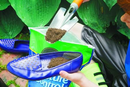 Gardening Lab for Kids Shoe Garden Project  Add soil to each shoe 051M