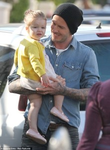 David Beckham holding Harper Seven